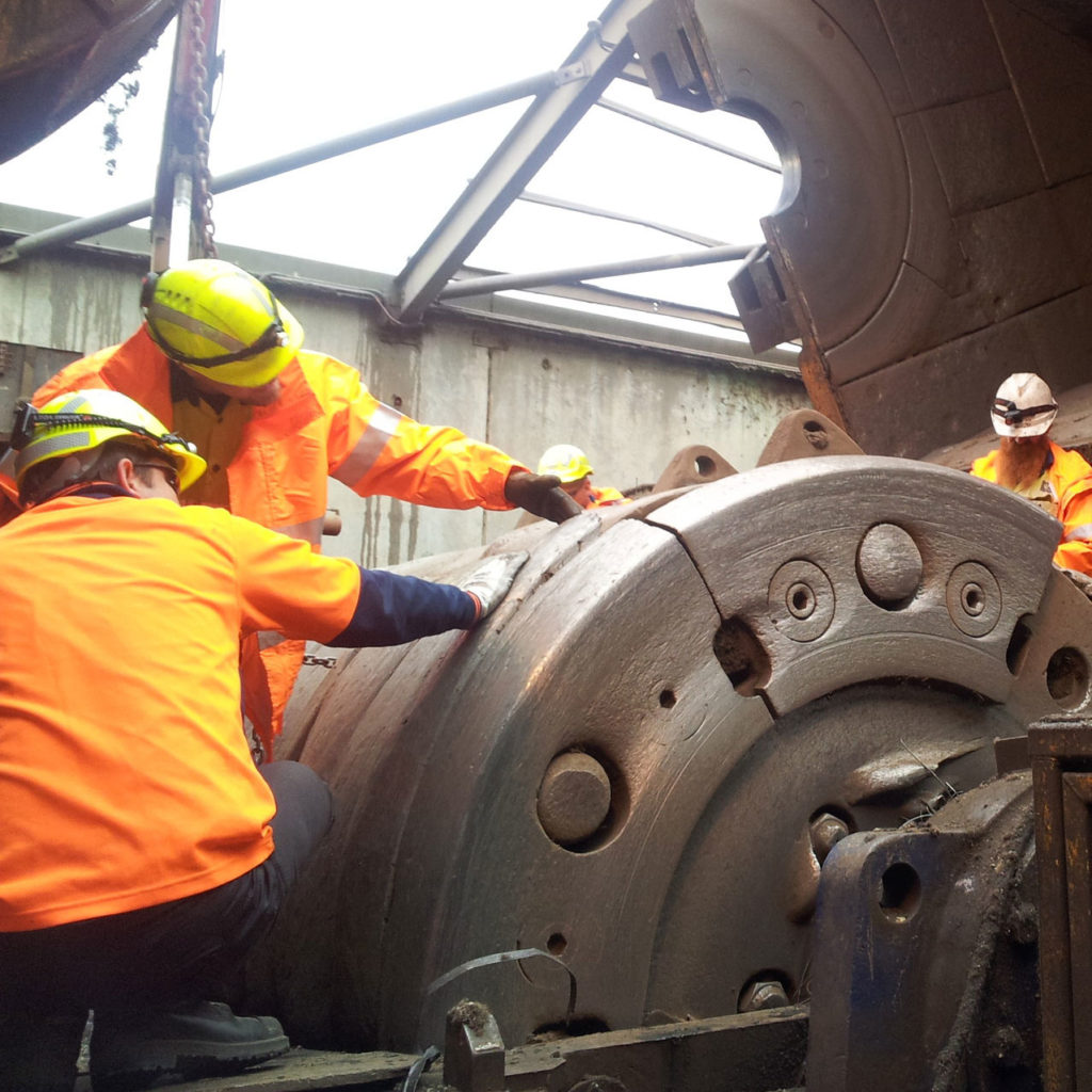 Engineers inspecting cracked drum