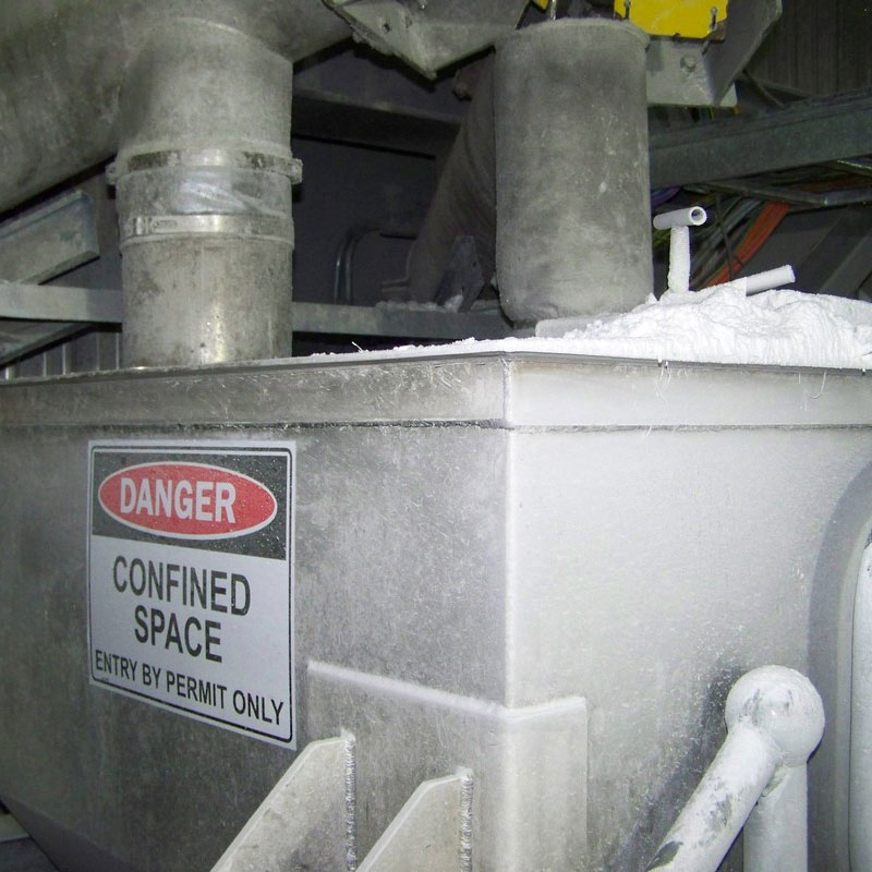 Equipment with confined space hazard signage