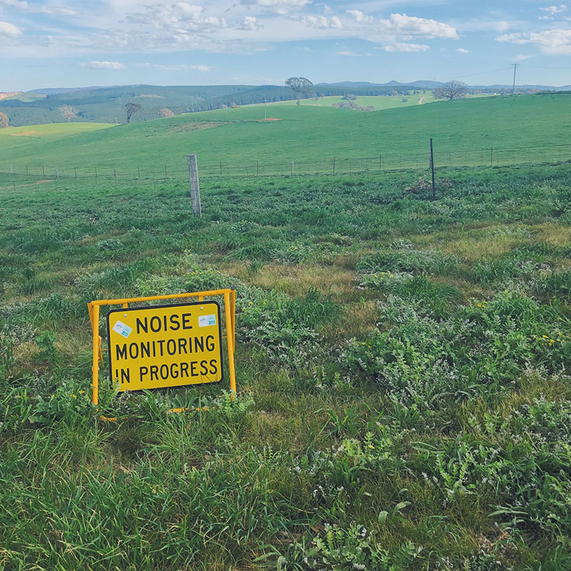 Noise monitoring in progress sign in a field