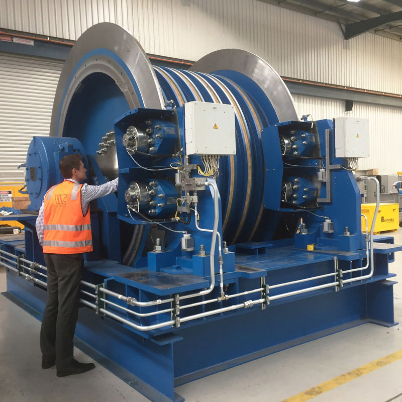 Man inspecting large machinery for safety